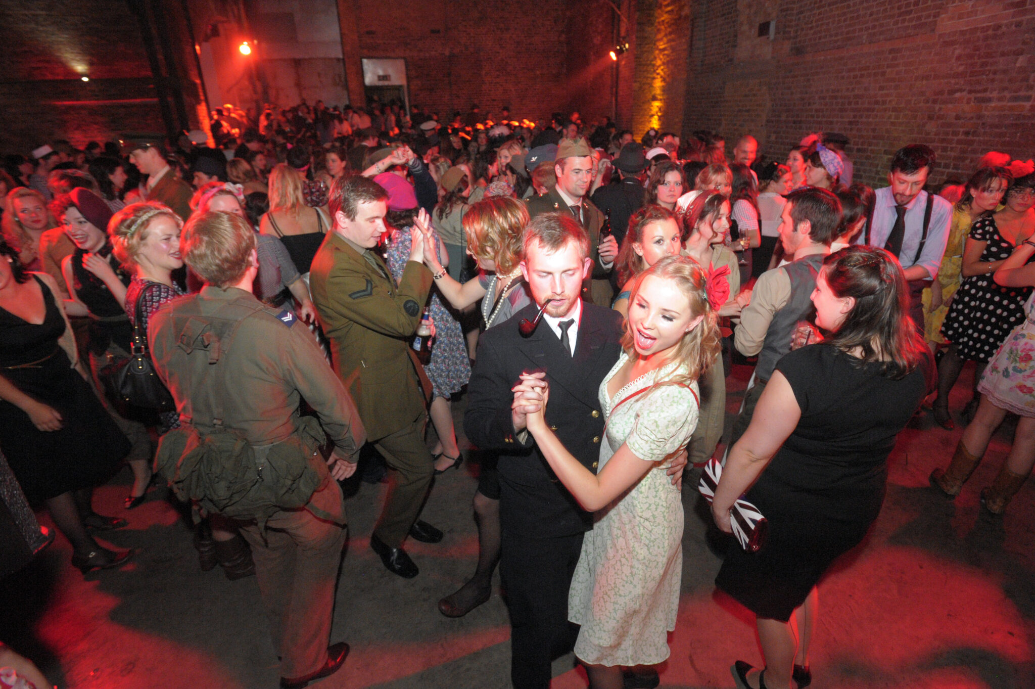 'Run For Shelter a night of Forties Fashion and Frolics On 65th Anniversary of D-Day' Coinciding with the 65th anniversary of D-Day, 6th June Blitz Party event under the railway arches in Shoreditch, [54 Holywell Lane , Ec2 ] remembering and honouring BritainÕs finest with 1940s music and dancing. Ê The Blitz Party gives party goers the opportunity to step back in time at our 1940s East End air raid shelter, where drinks, dancing and neighbourly spirit are the order of the evening. Ê Dress code: 1940's glam, home front utility clothing and allied uniform The venue transformed into a wartime East End air raid shelter; c/w : with sand bags, searchlights, blackout curtains, oil lamps & ration books replace bar menus and scarce provisions line the walls. The perfect setting to enjoy 1940s entertainment, including the UKÕs finest swing bands, performers and DJs, drink tasty cocktails and dance the night away. Ê www.theblitzparty.com part of the Bourne & Hollingsworth Group pics and copyright Nick Cunard commission The London Lite Ê