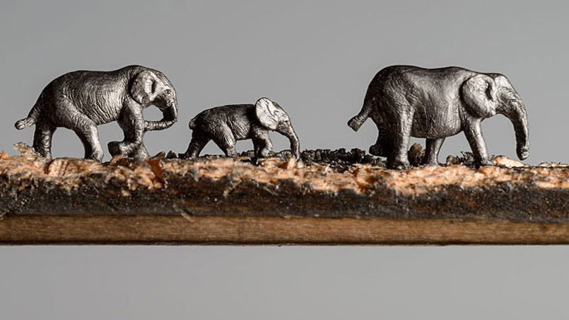 artist-carves-an-entire-herd-of-elephants-onto-a-pencil1-805x452