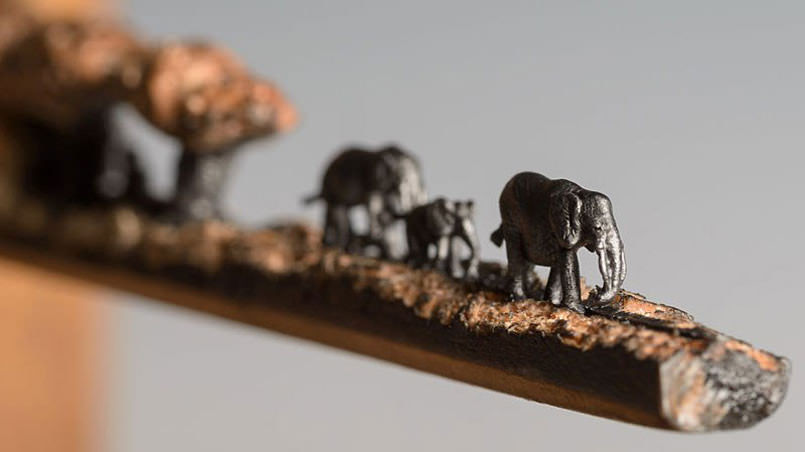 artist-carves-an-entire-herd-of-elephants-onto-a-pencil4-805x452